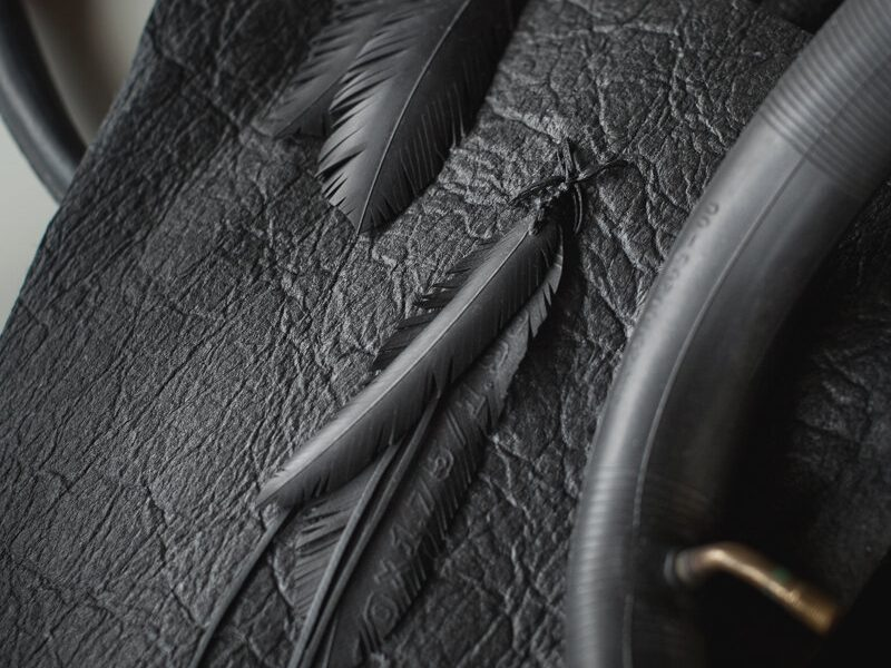 BIKE INNER TUBE: Feathers are made from discarded bike inner tube, cleaned & polished with massage oil. Upcycling discarded materials.